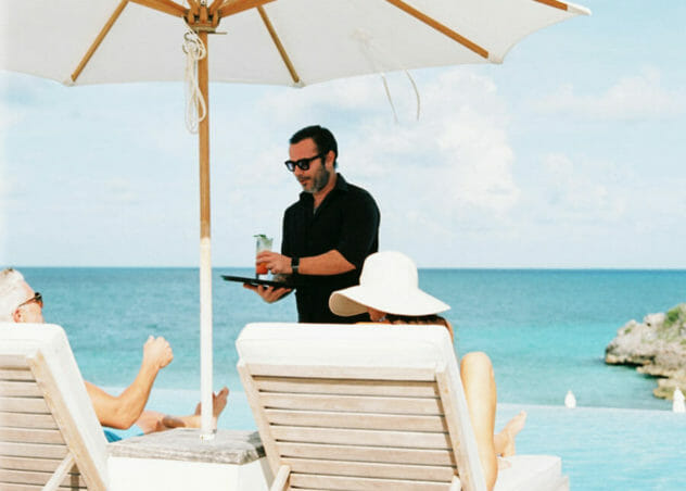 Couple sitting in front of infinity pool at Cove Eleuthera Bahamas