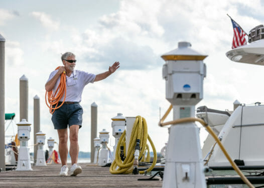 man walking on dockside
